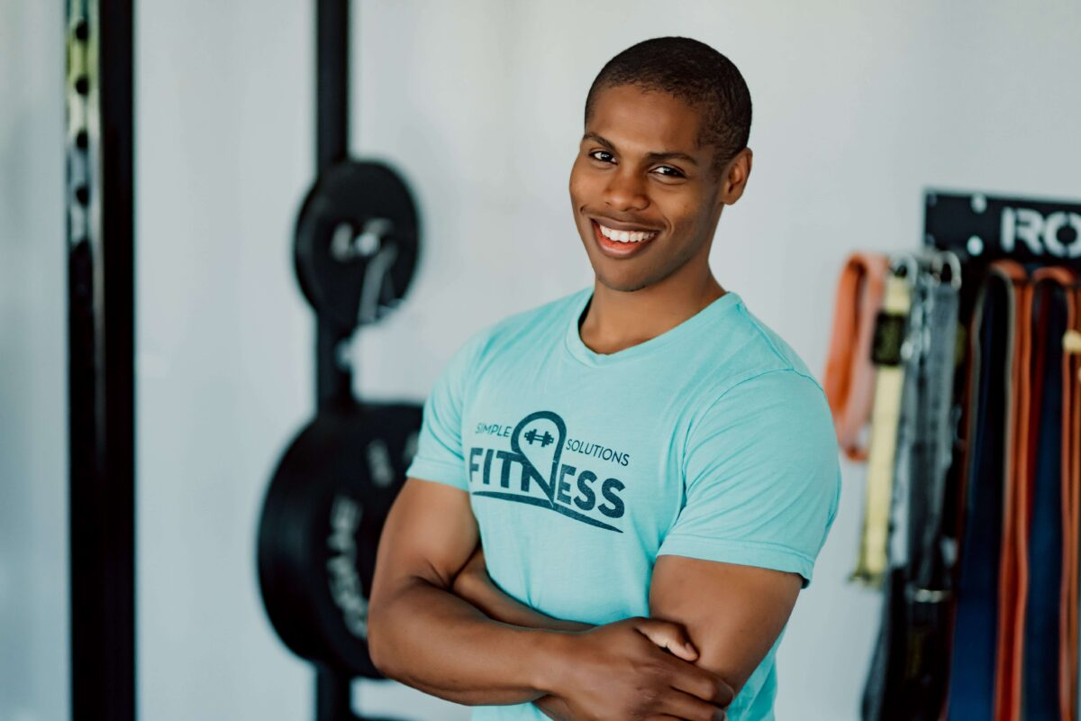 Personal Trainer Steven Mack smiling arms crossed